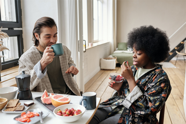 A woman and man having coffee together at a table