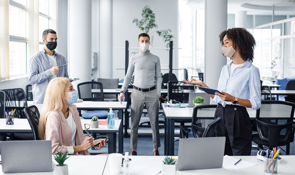 People social distancing in an office